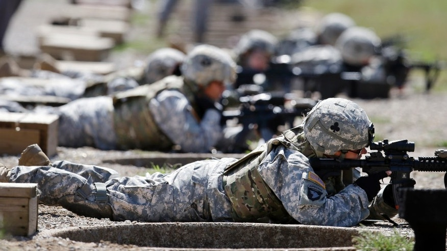 Sept. 18, 2012: Female soldiers train on a firing range while wearing new body armor.
