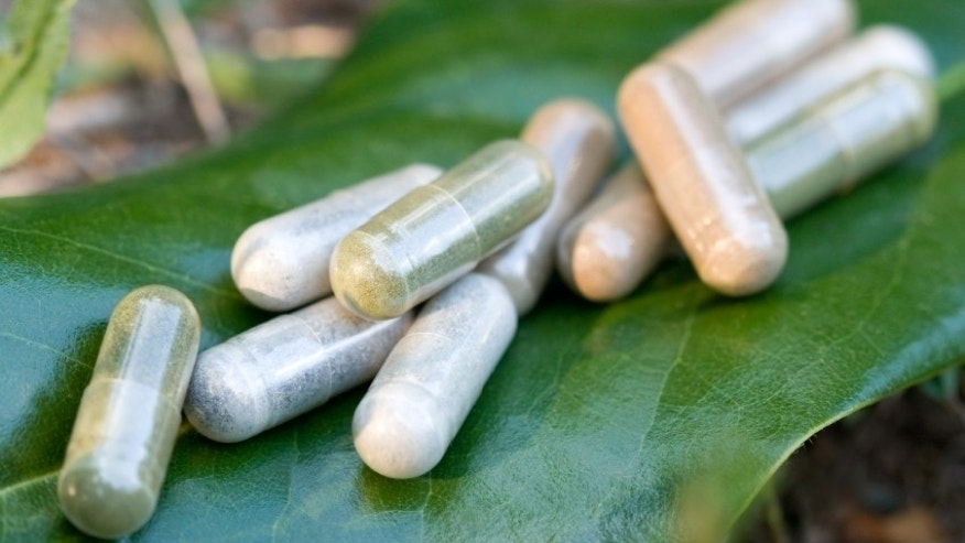 Herbal medicine capsules in a nature environment.