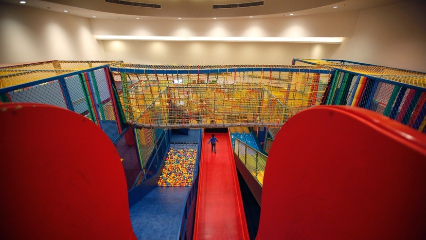 "A child plays at the indoor playground ""Adventure Zone"" at Kerry Hotel in Beijing February 12, 2015. REUTERS/Kim Kyung-Hoon"