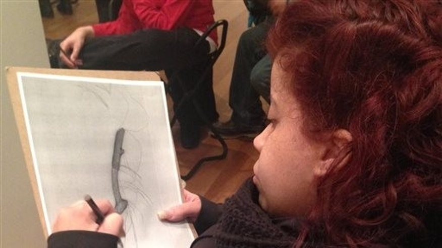 In this March 22, 2015 photo, Luz Cantres works on a drawing at the Museum of Modern Art in New York after viewing a sculpture by French artist Jean Dubuffet. (AP Photo/Ula Ilnytzky)