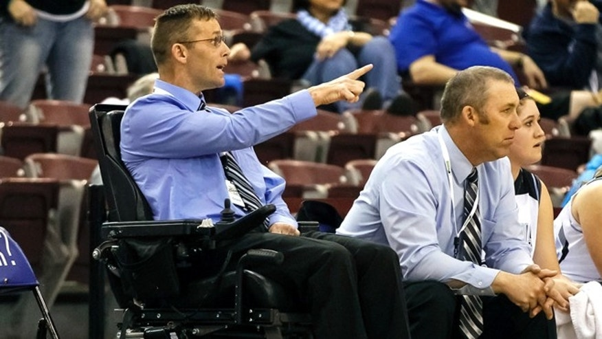 Dietrich head coach Acey Shaw shouts an instruction to his players during the first half of the Class 1A Div II State Championship high school basketball game against Richfield in Nampa, Idaho, on Saturday, Feb. 21, 2015. Richfield won 48-41 . (AP Photo/Otto Kitsinger)