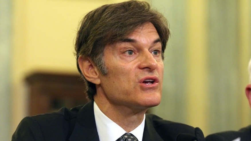 "In this June 17, 2014, file photo, Dr. Mehmet Oz, vice chairman and professor of surgery, Columbia University College of Physicians and Surgeons, testifies on Capitol Hill in Washington. Ten top physicians want Columbia University to remove the celebrity doctor from his medical faculty position. They cite what they call the heart surgeon's ""egregious lack of integrity"" as host of a television program where he promotes weight loss products."