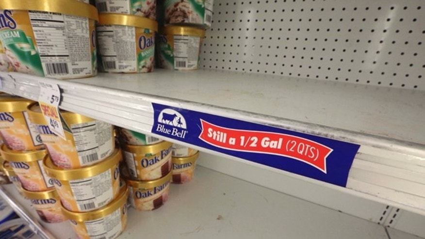 April 21, 2015: Shelves sit empty of Blue Bell ice cream at a grocery store in Dallas. Texas-based Blue Bell Creameries issued a voluntary recall Monday for all of its products on the market after two samples of chocolate chip cookie dough ice cream tested positive for Listeriosis. (AP Photo/LM Otero)