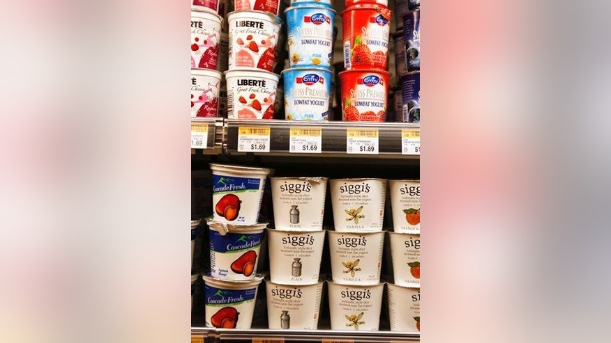 The yogurt section in a supermarket.