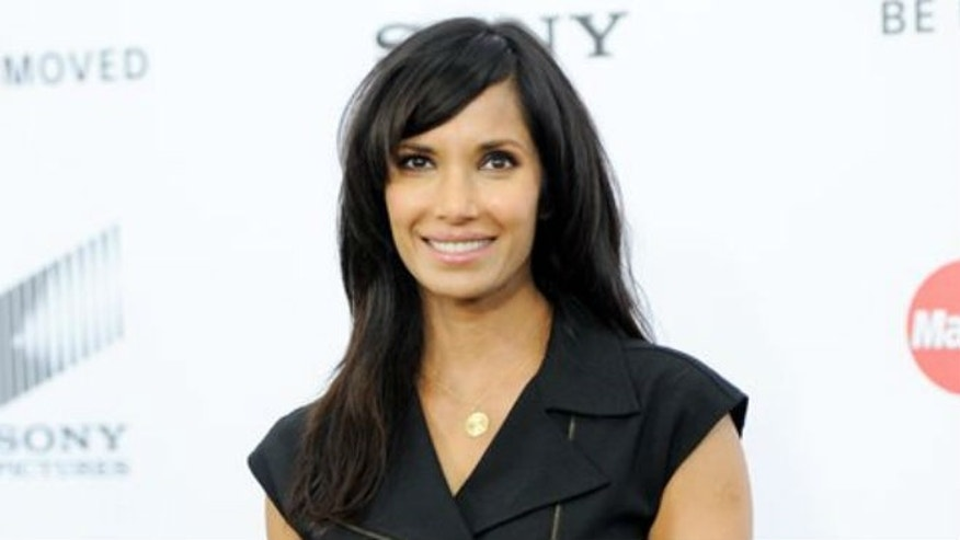 "In this Dec. 7, 2014, file photo, TV personality Padma Lakshmi attends the world premiere of ""Annie"" at the Ziegfeld Theatre in New York. Though Lakshmi loves exploring exotic foods on her show and in her travels, she grew up a strict vegetarian in India and follows a mostly vegetarian diet when she's not filming. (Photo by Evan Agostini/Invision/AP, File)"