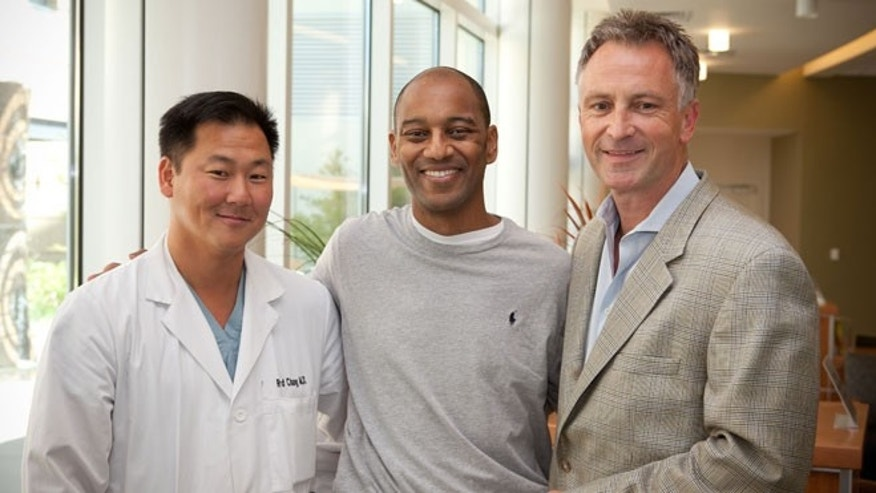 Dr. Richard Chang (left) and Dr. Andreas Kamlot (right) reunite with Curtis after his recovery. Dr. Chang and Dr. Kamlot implanted the Impella pumps that supported Curtis' heart and gave it time to heal.
