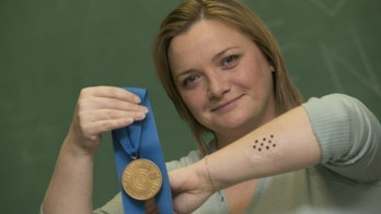 Sawicka, shown wearing a sample of the ImmunoMatrix patch, with her medal for winning first prize in the graduate division of the national Collegiate Inventors Competition. (image courtesy subject)