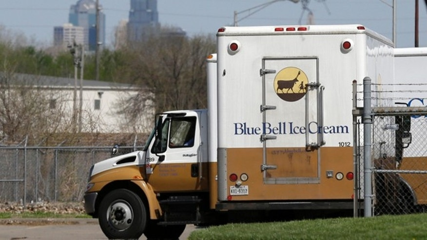 FILE -In this April 10, 2015 file photo, Blue Bell delivery trucks are parked at the creamery's location in Kansas City, Kansas. Blue Bell ice cream had evidence of listeria bacteria in its Oklahoma manufacturing plant as far back as March 2013, a government investigation released Thursday says. (AP Photo/Orlin Wagner, File)