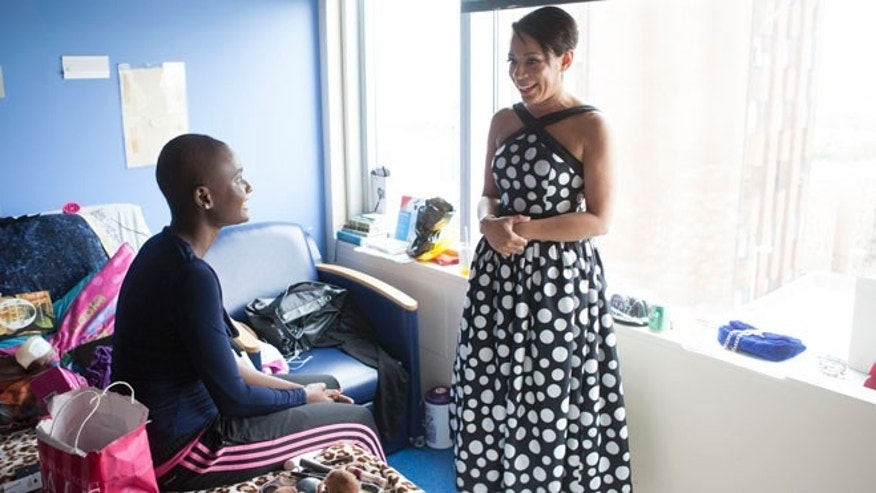 May 9, 2015: Essence White, 18, meets with actress Selenis Levya in her room before the prom at the Children's Hospital at Montefiore in New York City. (Gavin Thomas)