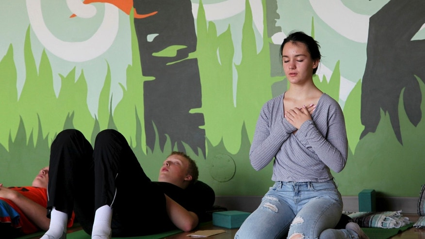 Oct. 1, 2014: In this photo, Nora Pearson, right, practices mindful breathing during the Mindful Studies class at Wilson High School in Portland, Ore.