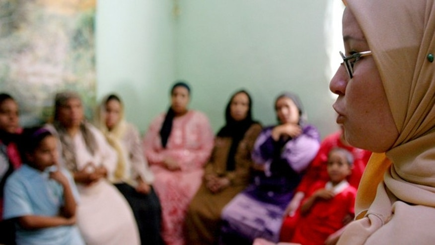 June 13, 2006: A counsellor talks to a group of women to try to convince them that they should not have FGM performed on their daughters in Minia, Egypt.