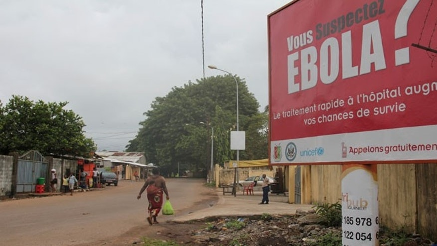 A billboard with a message about Ebola is seen on a street in Conakry, Guinea October 26, 2014.
