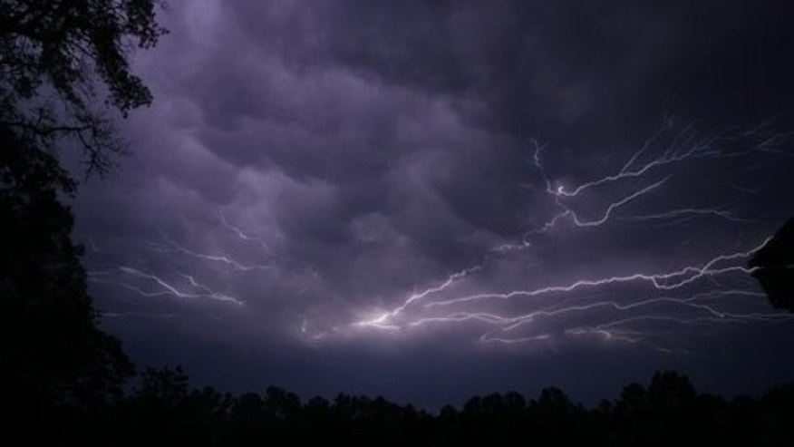 Lightning streaks across the sky in Tyler, Texas as a powerful line of thunderstorms, several spawning tornados moved across Texas, Tuesday evening, April 3, 2012.