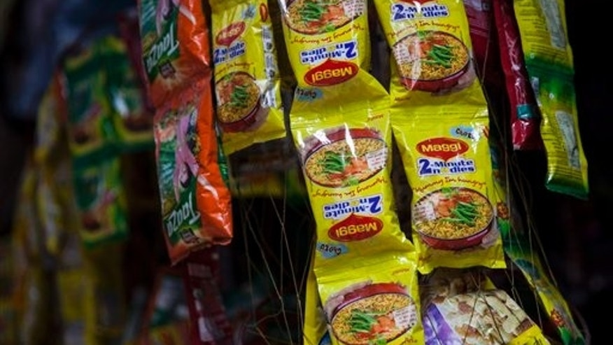 Packets of Maggi noodles hang on display at a shop in New Delhi, India, Wednesday, June 3, 2015. (AP Photo/Tsering Topgyal)