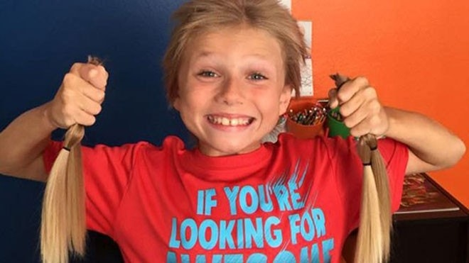 Boy endures teasing to grow hair 40 inches long for charity