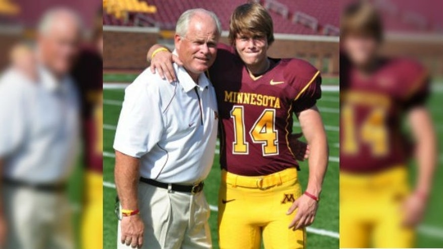 Connor with his dad, Kevin, then the defensive coordinator for the University of Minnesota. (image courtesy ComfPort)