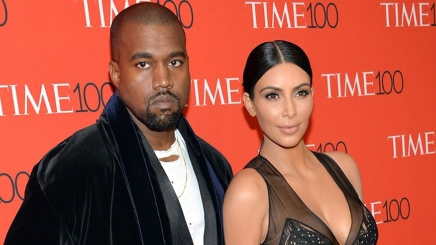 In this April 21, 2015 file photo, Kanye West, left, and Kim Kardashian attend the TIME 100 Gala, in New York. Kardashian and West are expecting a baby boy, the reality TV star's spokesperson confirmed Monday, June 22, 2015.