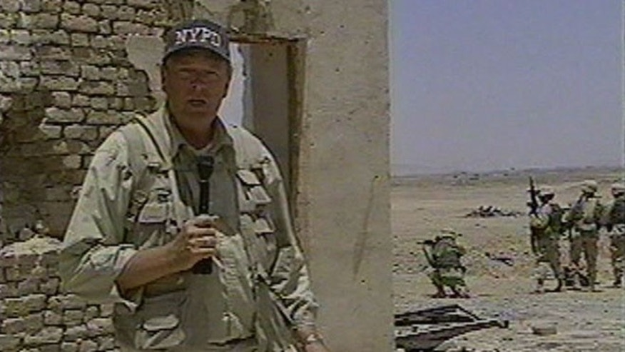Stogner pictured reporting onsite in Kandahar, Afghanistan in 2002.