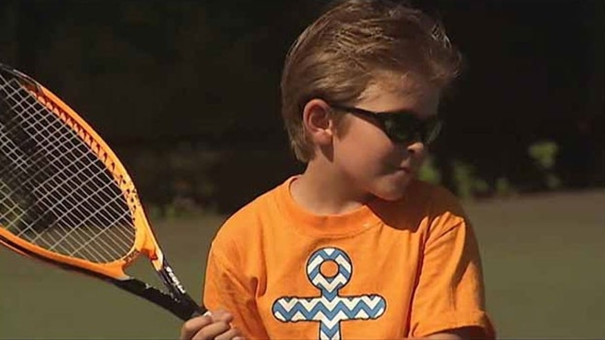 Aiden Rudder, 7, is pictured at a new tennis camp for the visually impaired in Atlanta, Ga.