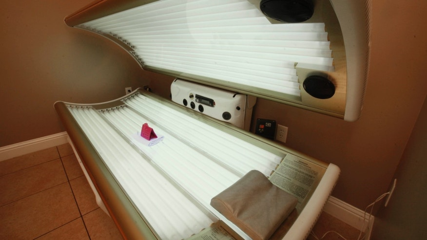This Dec. 9, 2011 file photo shows an open tanning booth at Amazing Tans in Sacramento, Calif.