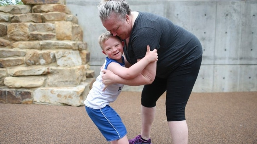 July 7, 2015: In this photo, Steven Heffron, 6, and his mother, Denise Watts, play in Smale Riverfront Park in downtown Cincinnati.