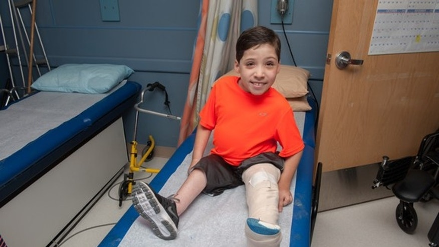 Tyler Bois, 9, has undergone 20 surgeries.