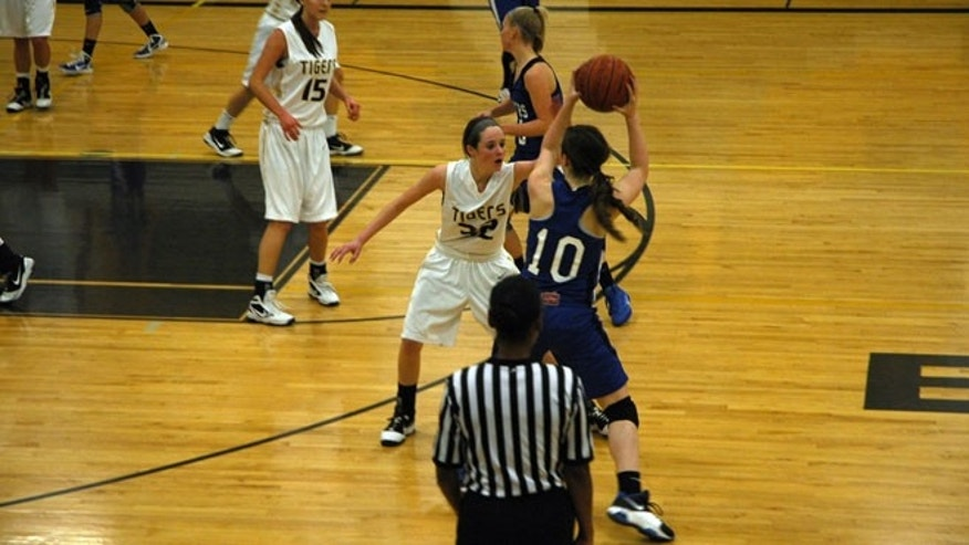 Kylee playing basketball during her sophomore year of high school in 2011, just before sustaining her second concussion in two months.