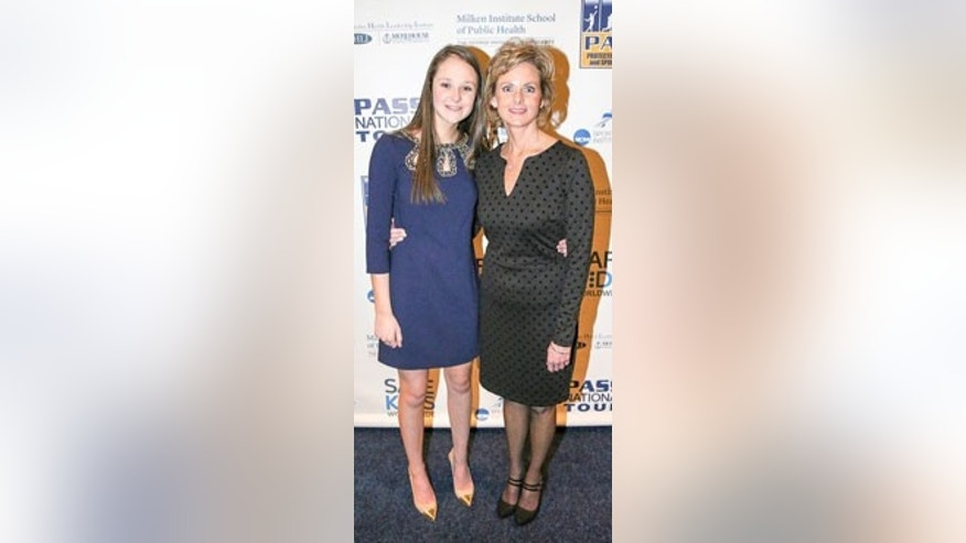 Kylee and her mom, Ginger Bliss, at the Protecting Athletes and Sports Safety (PASS) National Tour, 2015.