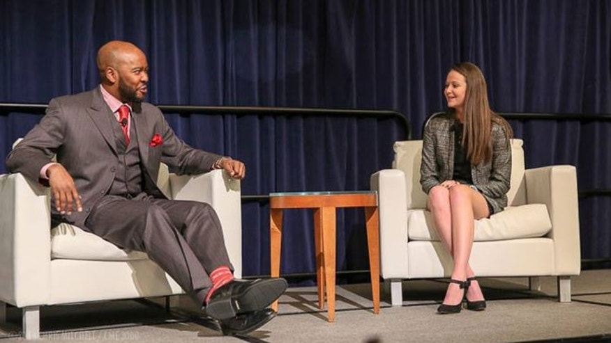 Kylee speaking with Ryan Cameron, announcer for the Atlanta Hawks, at the Protecting Athletes and Sports Safety (PASS) National Tour, 2015.