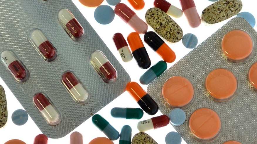 Pharmaceutical tablets and capsules in foil strips are arranged on a table in this picture illustration taken in Ljubljana September 18, 2013.  Picture taken September 18. REUTERS/Srdjan Zivulovic (SLOVENIA - Tags: HEALTH) - RTX15K29