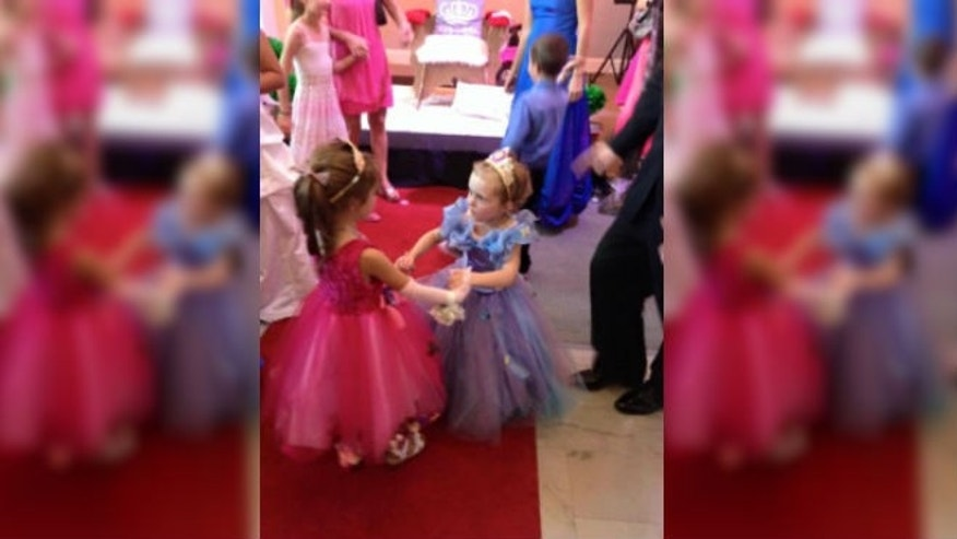 Lila May (in blue) dancing at her party with her sister (GiveForward)