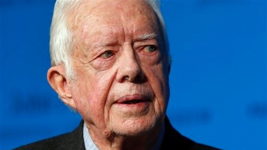 In this Thursday, Nov. 20, 2014 photo, former U.S. President Jimmy Carter speaks during a forum in Boston. On Wednesday, Aug. 12, 2015, Carter announced he has cancer and will undergo treatment at an Atlanta hospital. (AP Photo/Elise Amendola)