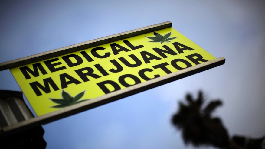 A sign advertises a medical marijuana dispensary on Venice Beach in Los Angeles, California, July 19, 2010. REUTERS/Lucy Nicholson