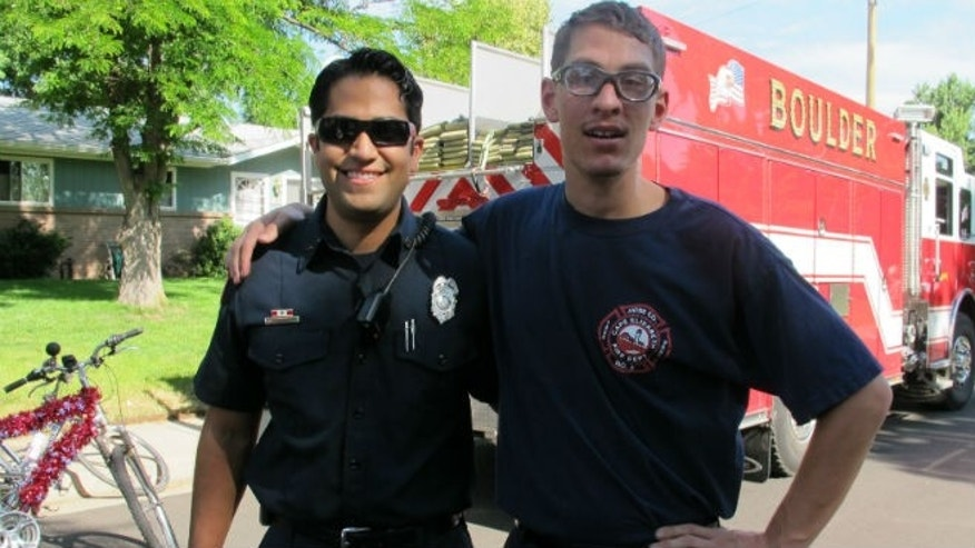 Ian with Matt Zavala of Boulder Fire-Rescue (image courtesy subject)