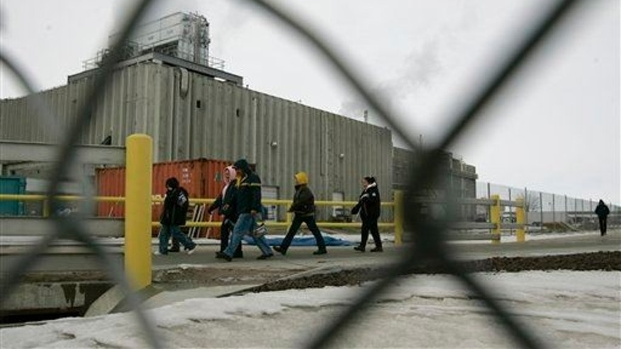 Workers at Tyson Foods' Holcomb, Kan., meatpacking plant are seen at a shift change.
