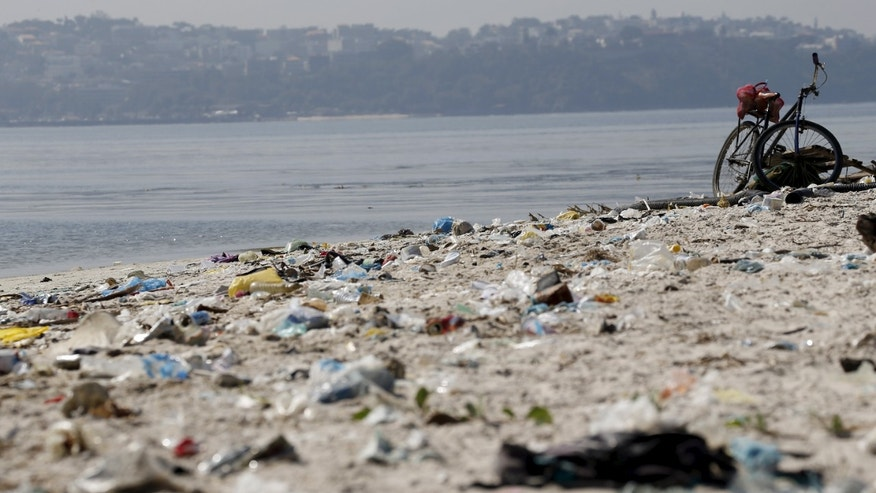 July 30, 2015: Rubbish is pictured at Fundao beach, on the banks of the Guanabara Bay, in Rio de Janeiro, Brazil. Rio de Janeiro continues to face criticism locally and abroad that the bodies of water it plans to use for competition in the 2016 Olympic Games are too polluted to host events. Untreated sewage and trash frequently find their way into the Atlantic waters of Copacabana Beach and Guanabara Bay - both future sites to events such as marathon swimming, sailing and triathlon events. Olympic sailors are not worried about getting sick during the Rio Olympics next year in spite of reports that waters where the sailing events will take place have pollution levels equivalent to raw sewage, competitors told Reuters.