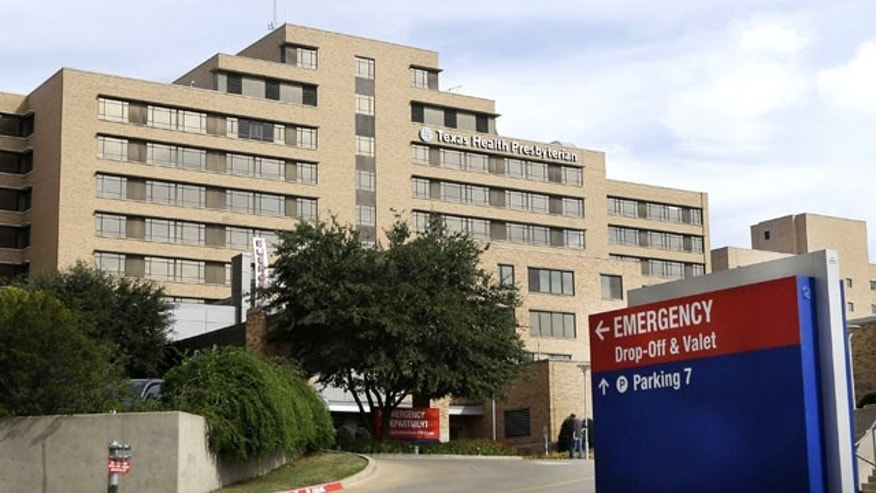 FILE - In this Oct. 8, 2014 file photo, a sign points to the entrance to the emergency room at Texas Health Presbyterian Hospital Dallas, where U.S. Ebola patient Thomas Eric Duncan was being treated, in Dallas. (AP Photo/LM Otero, File)