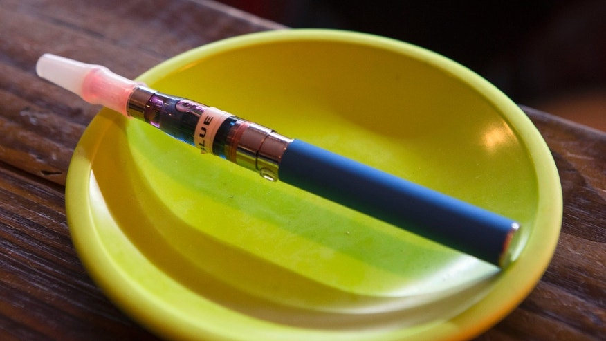 An e-cigarette sits in a tray on the bar at the Henley Vaporium in New York City December 18, 2013. (REUTERS/Mike Segar)