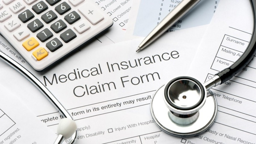 Close up of a medical insurance form with stethoscope