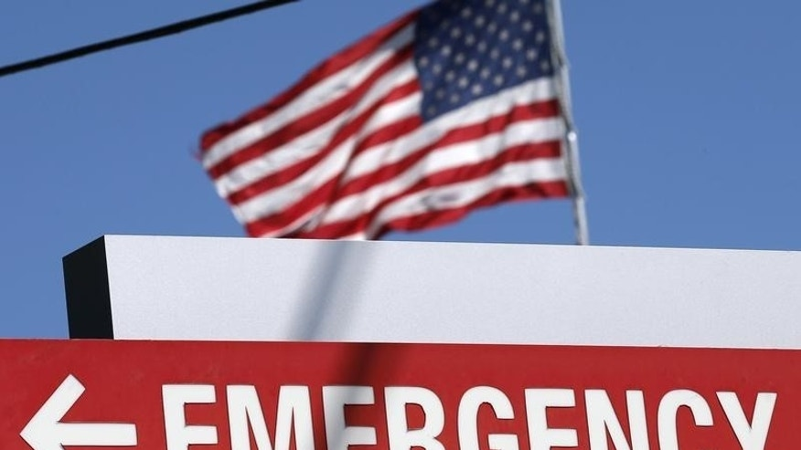 An entrance sign to the Texas Health Presbyterian Hospital is seen in Dallas, Texas, October 4, 2014.  REUTERS/Jim Young