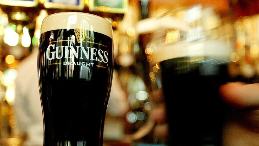 Pints of Guinness are seen in a pub. (REUTERS/Peter Macdiarmid)