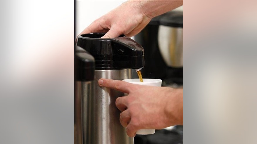 A man fills a cup with coffee at the East Daily Grind in Waterloo, Iowa, Thursday, Feb. 12, 2015.