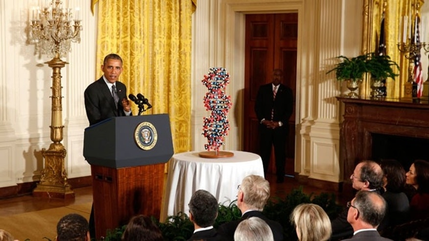 U.S. President Barack Obama talks about investments to improve health and treat disease through precision medicine while in the East Room of the White House in Washington January 30, 2015. A 17 base pair DNA model is next to Obama.