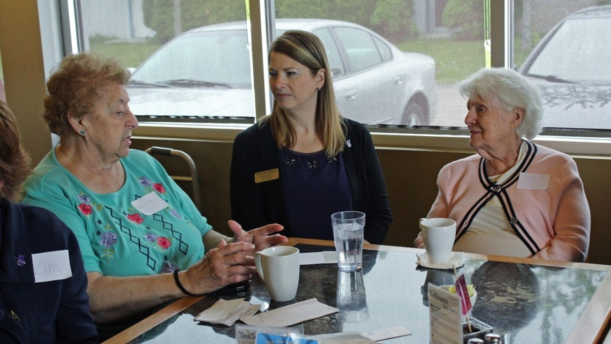 May 20, 2015: In this photo taken at Connections Cafe in Watertown, Wis., Shirley Strysick, right, 90, who suffers from dementia, talks with Stephanie Masche, center, from Heritage Homes assisted living facility, and an unidentified woman during a social and support group for those with the disease and their caregivers.