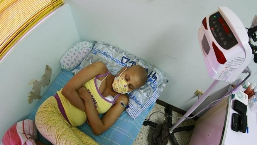 Esthefany Gonzalez, 17, rests on a bed after receiving chemotherapy treatment at a paediatric hospital in Maracaibo December 7, 2011. The 10-year-old hospital receives almost 2000 cancer-stricken children every year from Venezuela and Colombia. Picture taken December 7, 2011. REUTERS/Isaac Urrutia