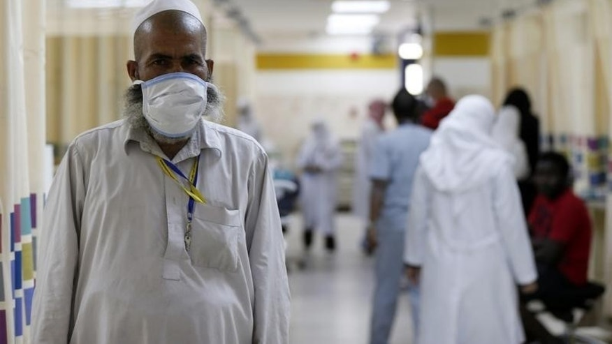 A Muslim pilgrim wears a protective mask in the emergency department at Al-Noor Specialist Hospital in Mecca September 30, 2014. REUTERS/ Muhammad hamed