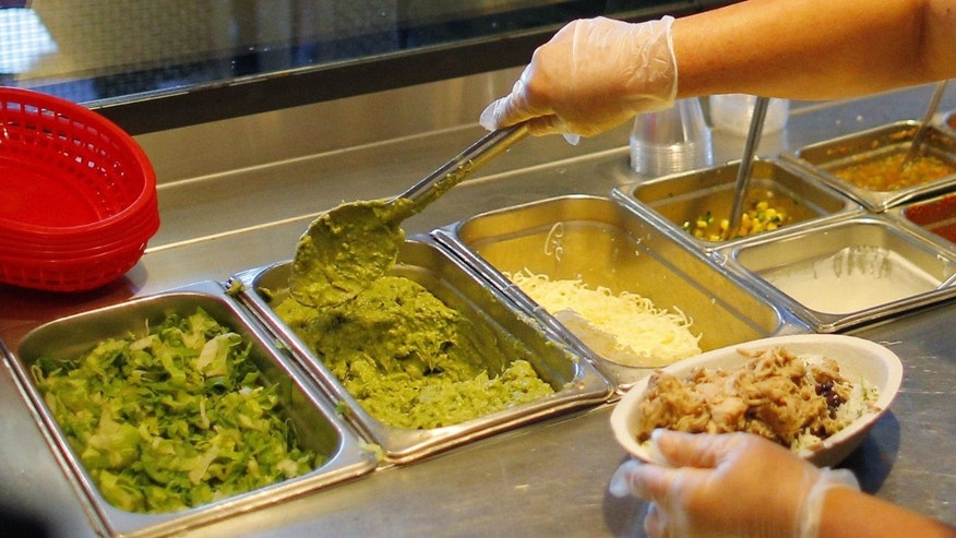 A carnitas burrito bowl gets the works at Chipotle.