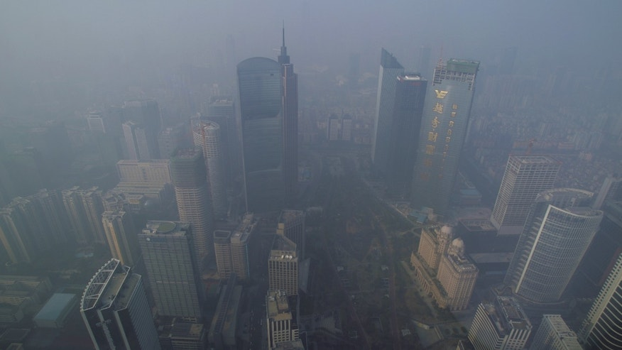 Buildings are seen through thick haze at the central business district in Guangzhou, Guangdong province in China.