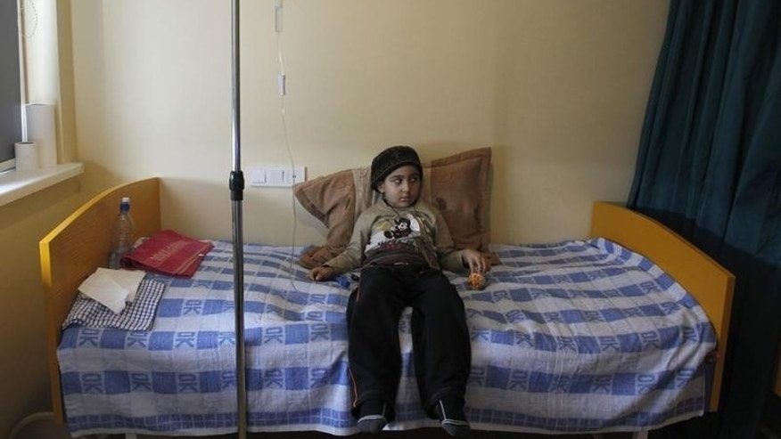 A child with leukaemia lies on her bed in the onco-hematology department of the Iashvili Central Children's Hospital in Tbilisi April 7, 2011.REUTERS/David Mdzinarishvili