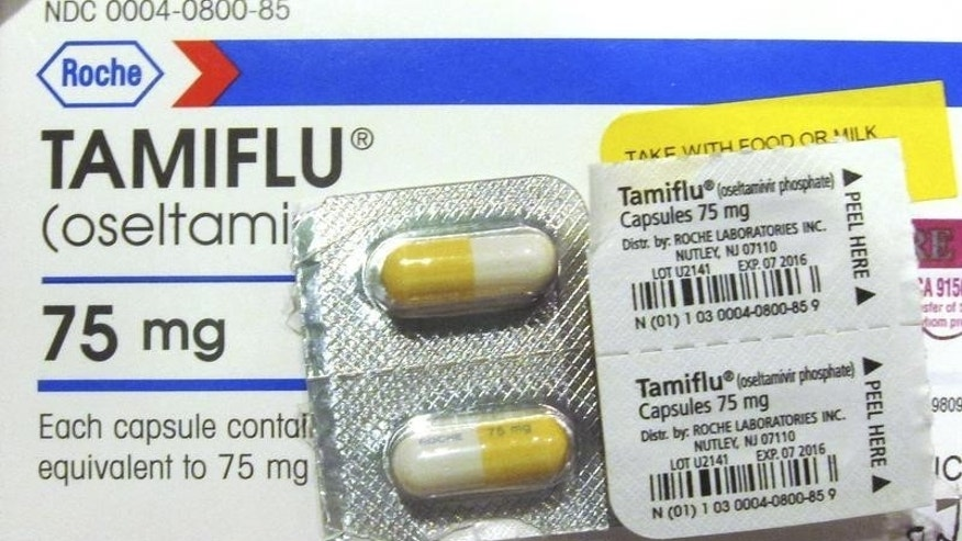 Four capules of Tamiflu are pictured on a Tamiflu box in Burbank, California,  January 31, 2013.  REUTERS/Fred Prouser